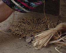 Lacandon woman making a basket crafts with the plant fibers Stock Footage