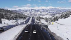 Interstate Highway in Snowy Mountains Stock Footage