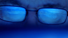 Screen reflected in glasses, tracking shot Stock Footage