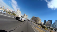 POV drive into Las Vegas city Highway traffic Casino Hotels blue sky Nevada USA - stock footage