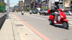 Kaohsiung busy street. Cars and motorbikes. Formosa Boulevard Station Stock Footage