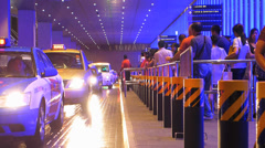 Asia Singapore Downtown passengers queue up for Taxi in rainy night Stock Footage