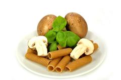 Baby bella mushrooms, pasta and basil Stock Photos