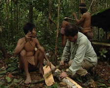 Mix of cultures. Caucasian man and Punan making cloth Stock Footage