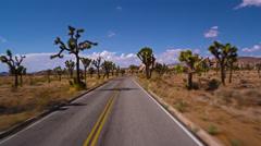 Pov driving through Joshua Tree's Hidden Valley HD Stock Footage