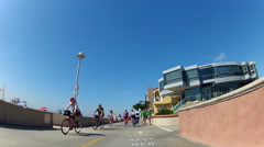 Riding Bicycle Past Expensive Beach Homes- Hermosa Beach CA Stock Footage