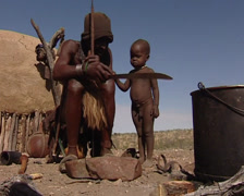 Himba sharpening their weapons Stock Footage
