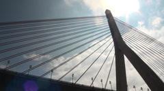 Kao Ping River Bridge in backlighting. Tilt down Stock Footage