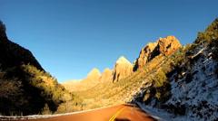 POV driving snow landscape dry climate vehicle transport Zion National Park Utah - stock footage