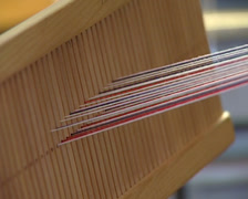 Working in a loom Stock Footage
