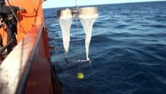 Scientific preparing a Bongo nets  to take samples of microorganisms Stock Footage