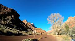 POV vehicle road trip sandstone cliffs extreme terrain blue sky Zion Utah USA - stock footage