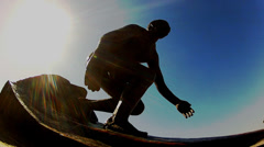 Low Angle Surfer Sculpture With Sun Flare- Hermosa Beach CA Stock Footage
