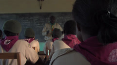 Kenya college and teacher scout explaining Stock Footage