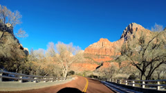 POV vehicle road drive sandstone rock extreme terrain Zion National Park Utah - stock footage