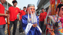 Costume of  Tu Di Gong in the procession of the god Matsu Stock Footage