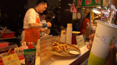 French chips stall in the Shilin Night Market. Danshui Stock Footage
