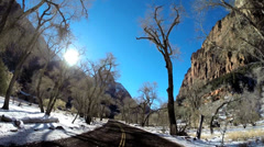 POV road trip driving valley landscape extreme climate snow Zion National Park Stock Footage
