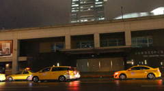 A night pan  of Taipei 101 displaying happy Stock Footage