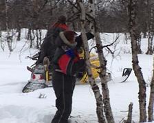 Snowmobile carriying firewood Stock Footage