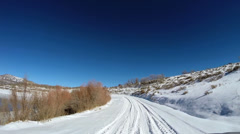 POV driving barren landscape blue dry climate vehicle transport Zion Utah USA - stock footage