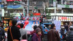 Political rally on a main street Stock Footage