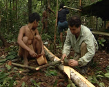 Stock Video Footage of Mix of cultures. Caucasian man and Punan making cloth