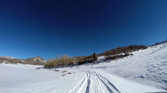POV driving snowy landscape altitude blue dry climate vehicle transport Utah USA - stock footage