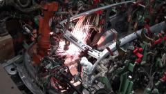 Car factory. robotic arm welding pieces Stock Footage