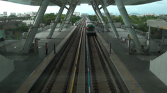 Overview subway leaving the World Games Station Stock Footage