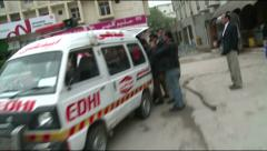 An Ambulance Reaches Twin Suicide Blast Scene at District Court in Islamabad Stock Footage