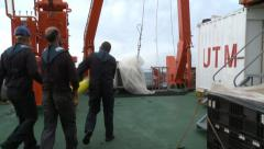 Scientist preparing the Argo buoy manouver Stock Footage