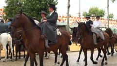 Horse riders walk the April Fair. Seville Stock Footage