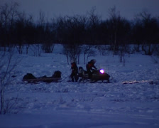 Snowmobile dragging sled Stock Footage