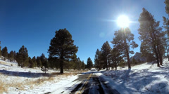 POV vehicle road trip winter snow sun flare blue sky Zion National Park Utah USA - stock footage
