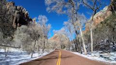 POV Zion Valley drive Navajo Sandstone rock cliffs winter snow National Park - stock footage