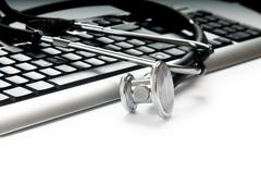 Stethoscope and keyboard illustrating concept of digital securit Stock Photos