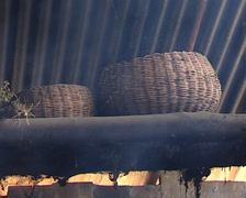Inside a hut Lacandon, top shelf with bananas and baskets Stock Footage