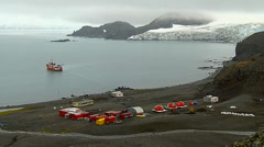 View of Juan Carlos I Station. Ocean, boat and glacier in backgrpund Stock Footage