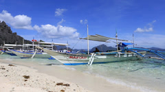 EL NIDO, PHILIPPINES: Boats waiting for tourists to travel between the islands Stock Footage