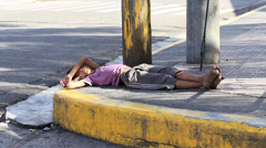 Poverty in Pholippines, a unidentified children sleeping on the street. Stock Footage