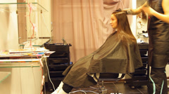 the girl in the Barber shop, color, lamination, dries hair - stock footage