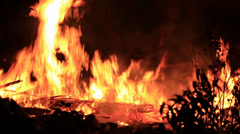 Fire burns out of control night Stock Footage