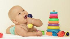 Baby plays with toy - stock footage