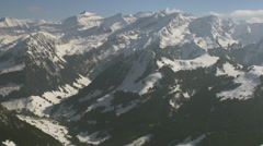 Gorgeous aerial tracking shot of snow covered Alps 1/4 -0001 Stock Footage