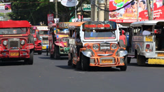 Jeepneys passing, Filipino inexpensive bus service Stock Footage