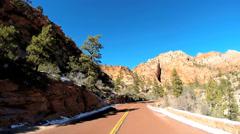 POV vehicle road trip winter snow Mountain cliffs Zion National Park Utah USA - stock footage