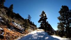 POV Zion Valley drive Navajo Sandstone rock cliffs snow National Park Utah - stock footage