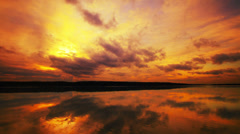 4K Apocalyptic sunset over lake, dramatic clouds run across sky, time-lapse. Stock Footage
