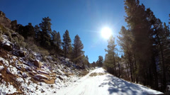 POV vehicle road trip extreme terrain sandstone rock winter snow Zion National - stock footage